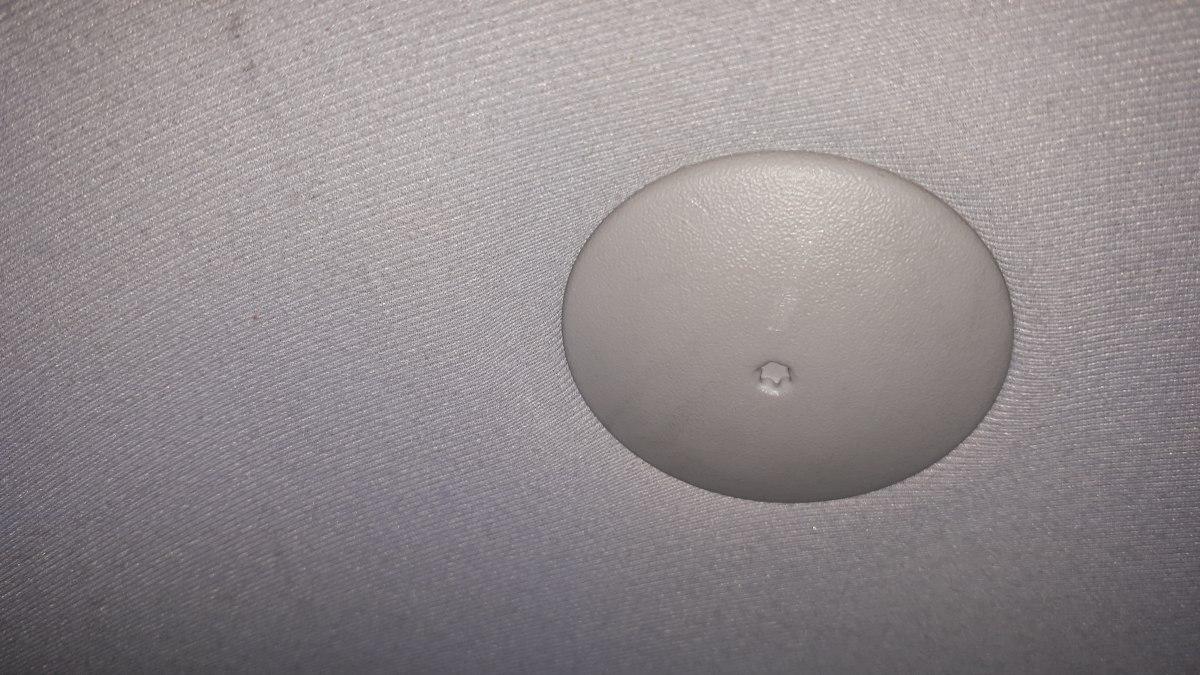 A tetőkárpit rögzítője